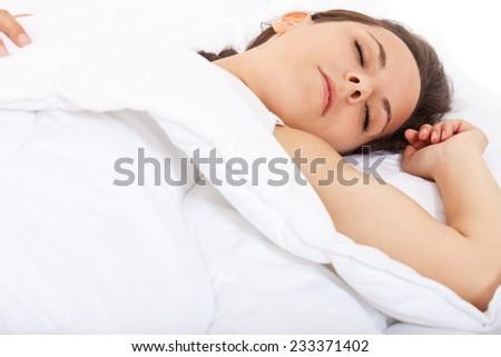 Attractive girl sleeping in bed. - stock photo