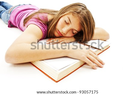 Attractive Girl Sleeping with Her Head on an Open Book - stock photo
