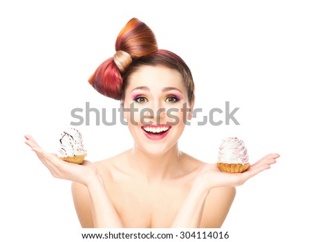 Attractive girl with a bow haircut holding cakes. - stock photo
