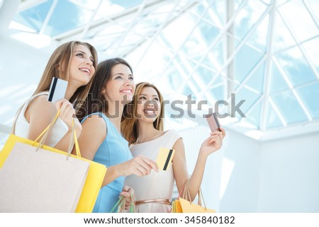 Attractive girl with a credit card in the store - stock photo