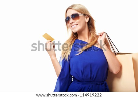Attractive girl with bags and credit card - stock photo