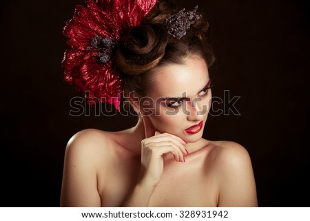 attractive girl with beautiful hairstyle and makeup studio