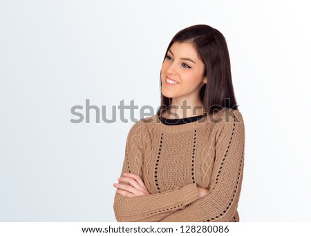 Attractive girl with crossed arms isolated on blue background - stock photo