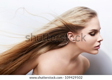 Attractive girl with flying hair