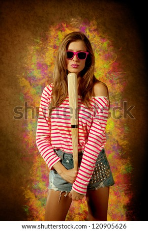 Attractive girl with jeans panties and baseball bat over vintage background - stock photo