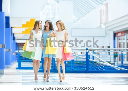 Attractive girl with shopping bags indoors - stock photo