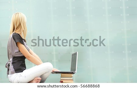 Attractive girl  with the notebook - stock photo