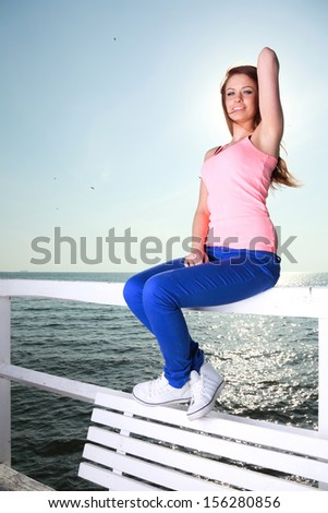 Attractive girl Young woman looking on background of sea sky