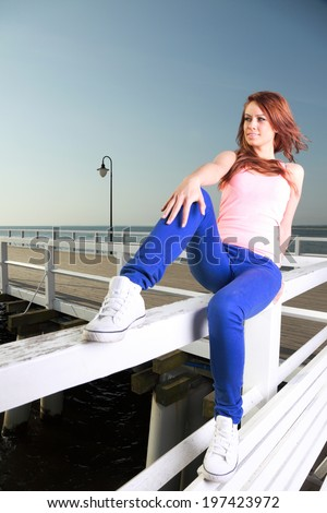 Attractive girl Young woman looking on background of sea sky - stock photo