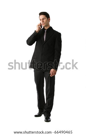 attractive,good looking  businessman is talking on his cell telephone with worried expression. These images can be used for some business stress concept. - stock photo