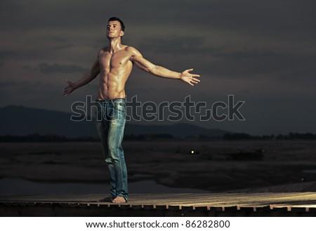 Attractive guy posing - stock photo