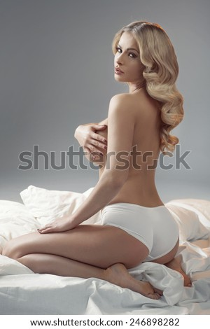 Attractive half-naked blonde beauty - stock photo