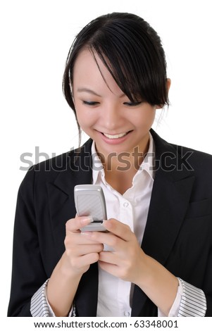 Attractive happy business woman reading SMS on cellphone against white. - stock photo