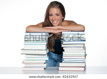 attractive happy girl with pile of books - stock photo