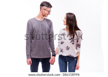Attractive happy love hipster  couple look each other and smile. Caucasian couple against white background. - stock photo