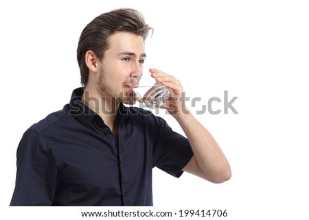 Attractive happy man drinking water from a glass isolated on a white background - stock photo