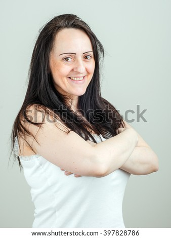 Attractive, happy middle aged smiling woman with folded arms. Portrait with copy space. - stock photo