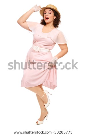 Attractive happy plus-size woman in vintage dress and straw hat