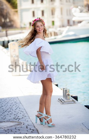 Attractive happy young woman in summer day on sea background - stock photo