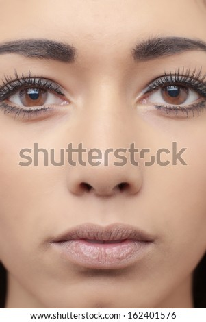 attractive head shot of asian woman shot in the studio looking at camera