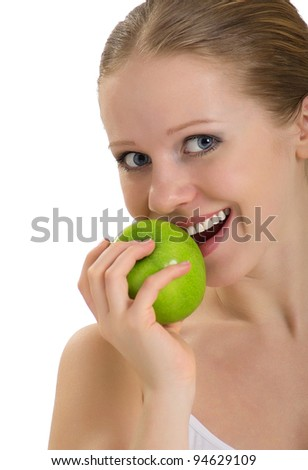 attractive healthy girl biting an apple isolated on white background - stock photo