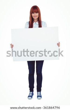 Attractive hipster woman holding white card against white background