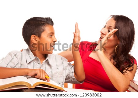 Attractive Hispanic Mother and Son Studying Isolated on a White Background. - stock photo