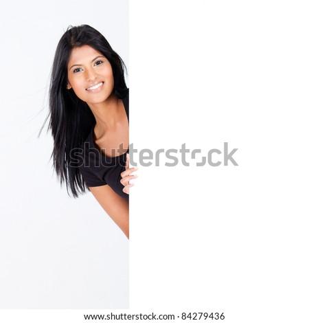 attractive hispanic woman behind blank white board - stock photo