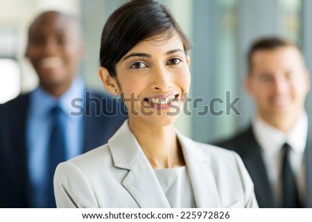 attractive indian business executive with business team - stock photo