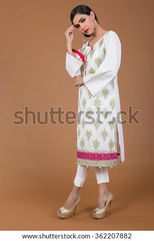 attractive Indian female model posing for camera - stock photo