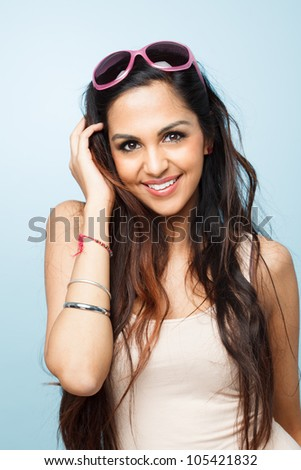 Attractive indian woman fashion model posing sexy blue background - stock photo