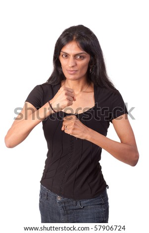 Attractive Indian woman holding her fists up in a defensive position. On white background.