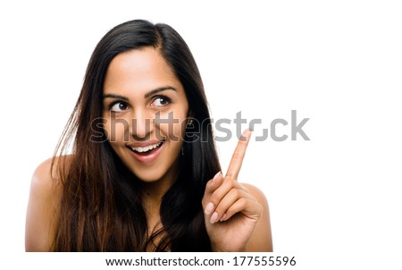 attractive Indian woman pointing - stock photo