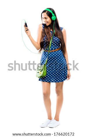 Attractive Indian woman taking selfie self portrait fashion model white background - stock photo
