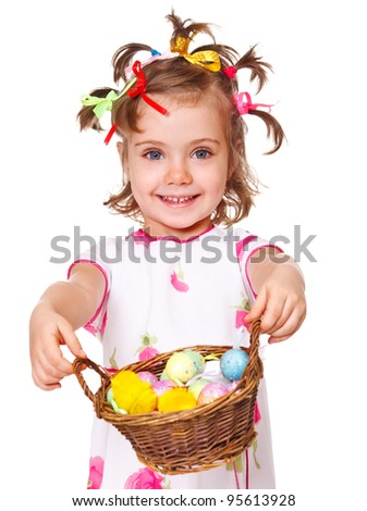 Attractive kid holding spring basket with Easter eggs - stock photo