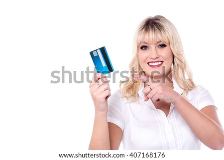 Attractive lady pointing at smart card - stock photo