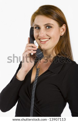 Attractive lady talking on a phone against a white background - stock photo
