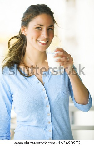 attractive lady with a glass of milk - stock photo