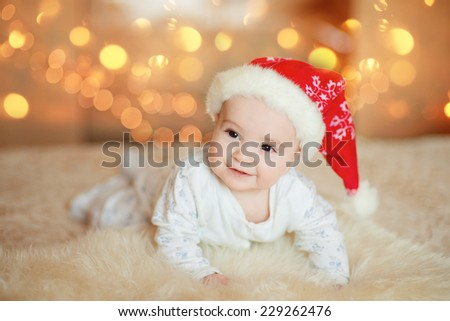 attractive little baby boy in Santa hat - stock photo