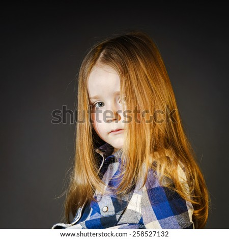 Attractive little girl close-up portrait, isolated on black - stock photo