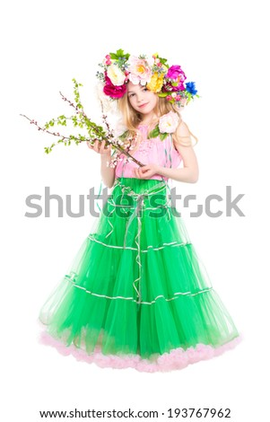 Attractive little girl posing with flowering branches. Isolated on white - stock photo