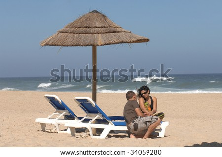 attractive lovely couple relaxing on the beach
