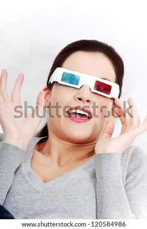 Attractive lovelywoman at home enjoying watching 3d movie - stock photo
