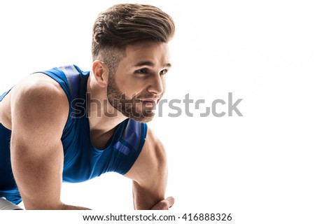 Attractive male jogger is waiting for start