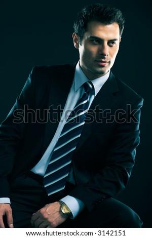 Attractive male model - fashion concept portrait in low key technique - crossprocessed - stock photo