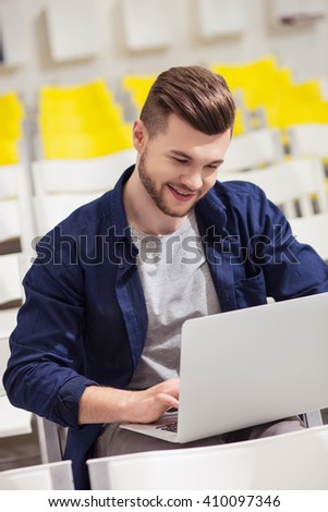 Attractive male student is studying with computer