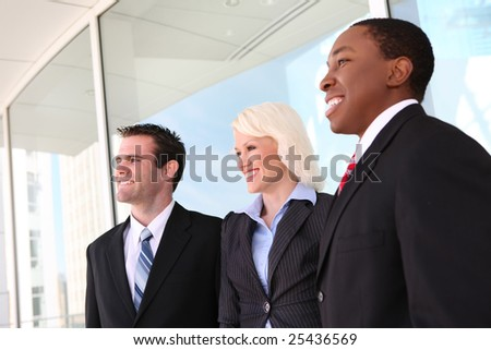 Attractive man and woman diverse business team at  office building