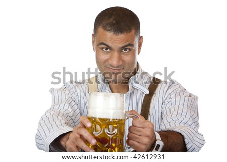Attractive man dressed in leather trousers (Lederhose) holds Oktoberfest beer stein in both hands into camera.  Isolated on white. - stock photo