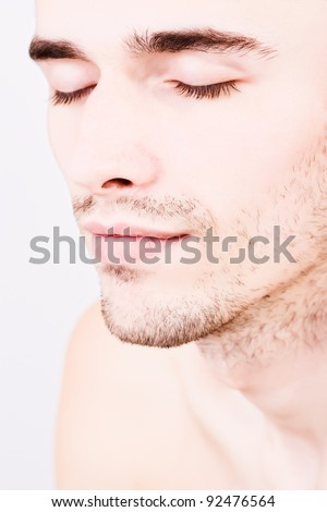 attractive man face, eyes closed - stock photo