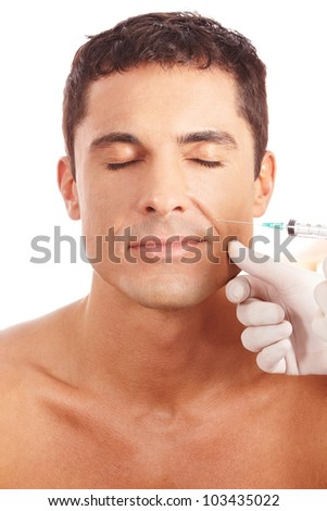 Attractive man getting wrinkle treatment with syringe - stock photo